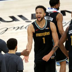 Memphis Grizzlies forward Kyle Anderson (1) and other teammates celebrate as they defeat the Utah Jazz in game one of their NBA playoff series at Vivint Arena in Salt Lake City on Sunday, May 23, 2021. Memphis won 112-109.