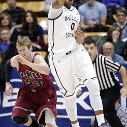 Brigham Young Cougars forward Brandon Davies (0) rebounds on Loyola Marymount Lions guard Chase Flint (23) in Provo  Thursday, Jan. 3, 2013.