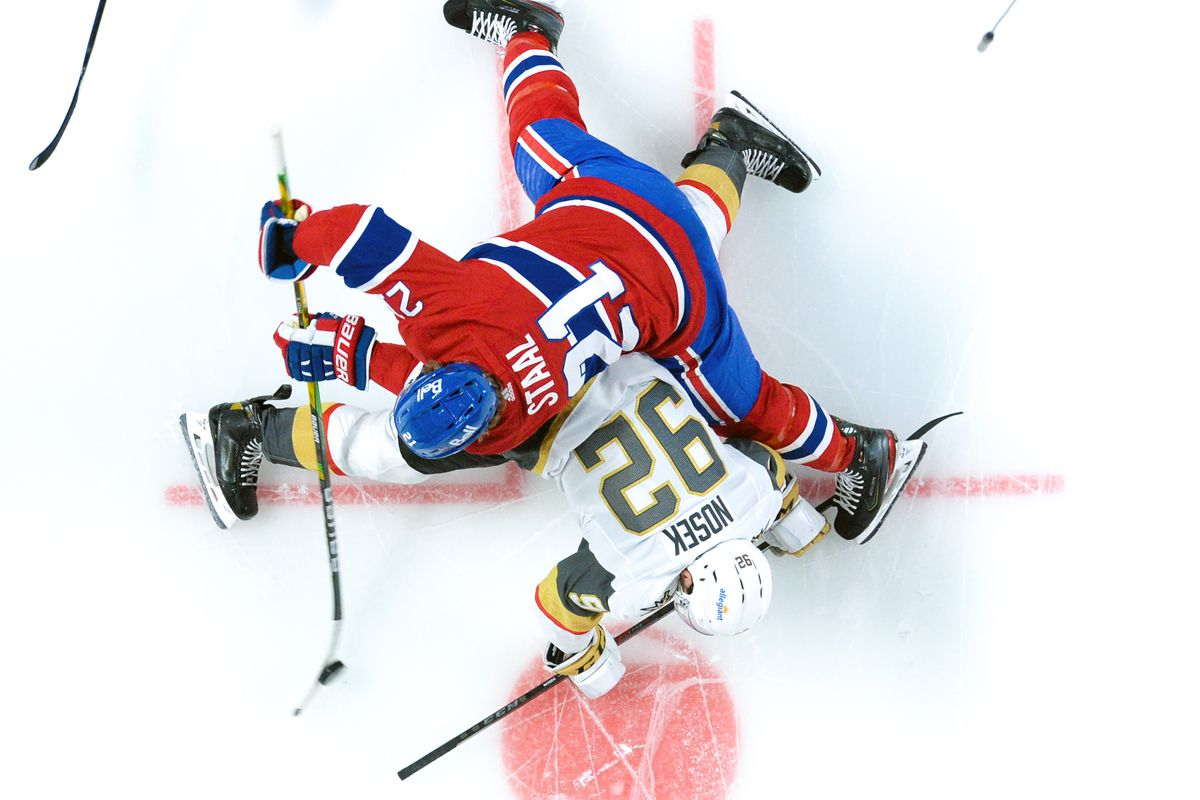 Eric Staal #21 of the Montreal Canadiens faces off against Tomas Nosek #92 of the Vegas Golden Knights in Game Three of the Stanley Cup Semifinals of the 2021 Stanley Cup Playoffs at the Bell Centre on June 18, 2021 in Montreal, Quebec, Canada.