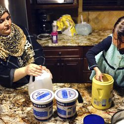 In this Thursday, Jan. 26, 2017 photo, Dalal Alia, 35, and her daughter, Yara Dalati, 5, prepare dinner at their home in Anaheim, Calif. Dalal Alia is originally from Syria and still has brothers, nieces and nephews she fears are in danger and will not be able to reach the U.S. under President Donald Trump's administration.