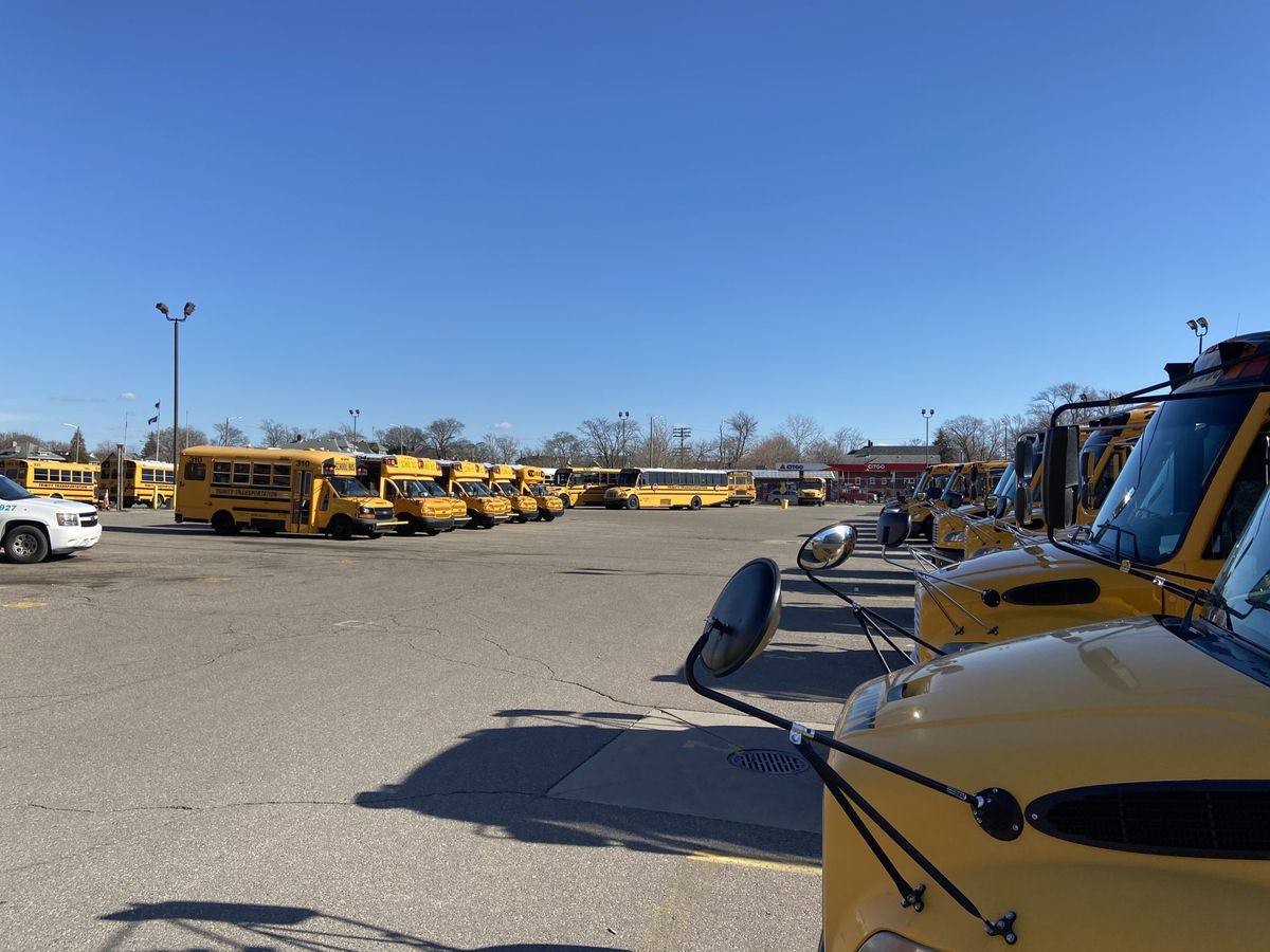 School buses sat idle in a Detroit lot on March 13, 2020. The governor ordered all schools closed for three weeks to slow the spread of the new coronavirus.