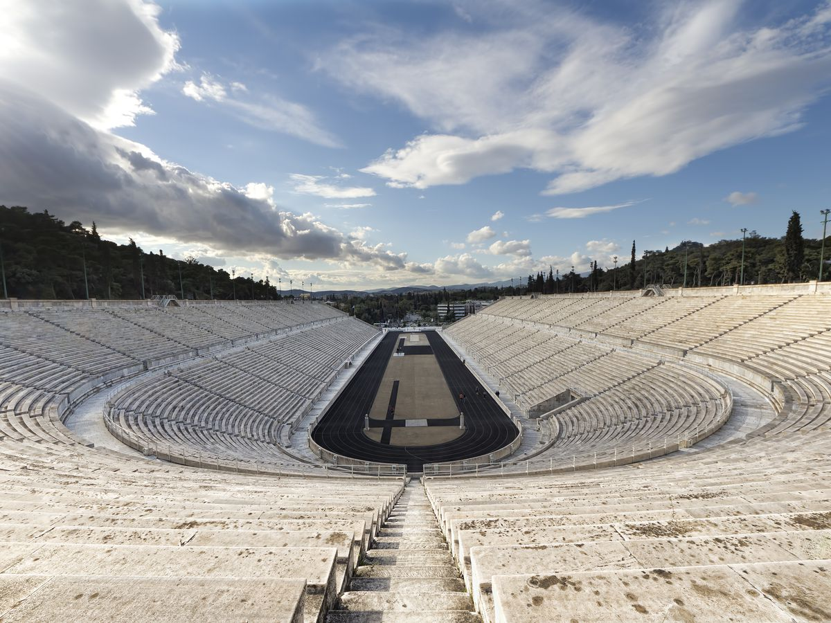 An aerial view of the Panathenaic Stadium in Athens. The stadium is circular in shape with many seats.