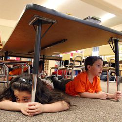 Mckenna Salas, left, and Treyson Howard, students in Danielle Wilson's kindergarten class, participate in an earthquake drill at Vista Elementary in Taylorsville, Tuesday, April 17, 2012. This was part of the Great Utah ShakeOut.