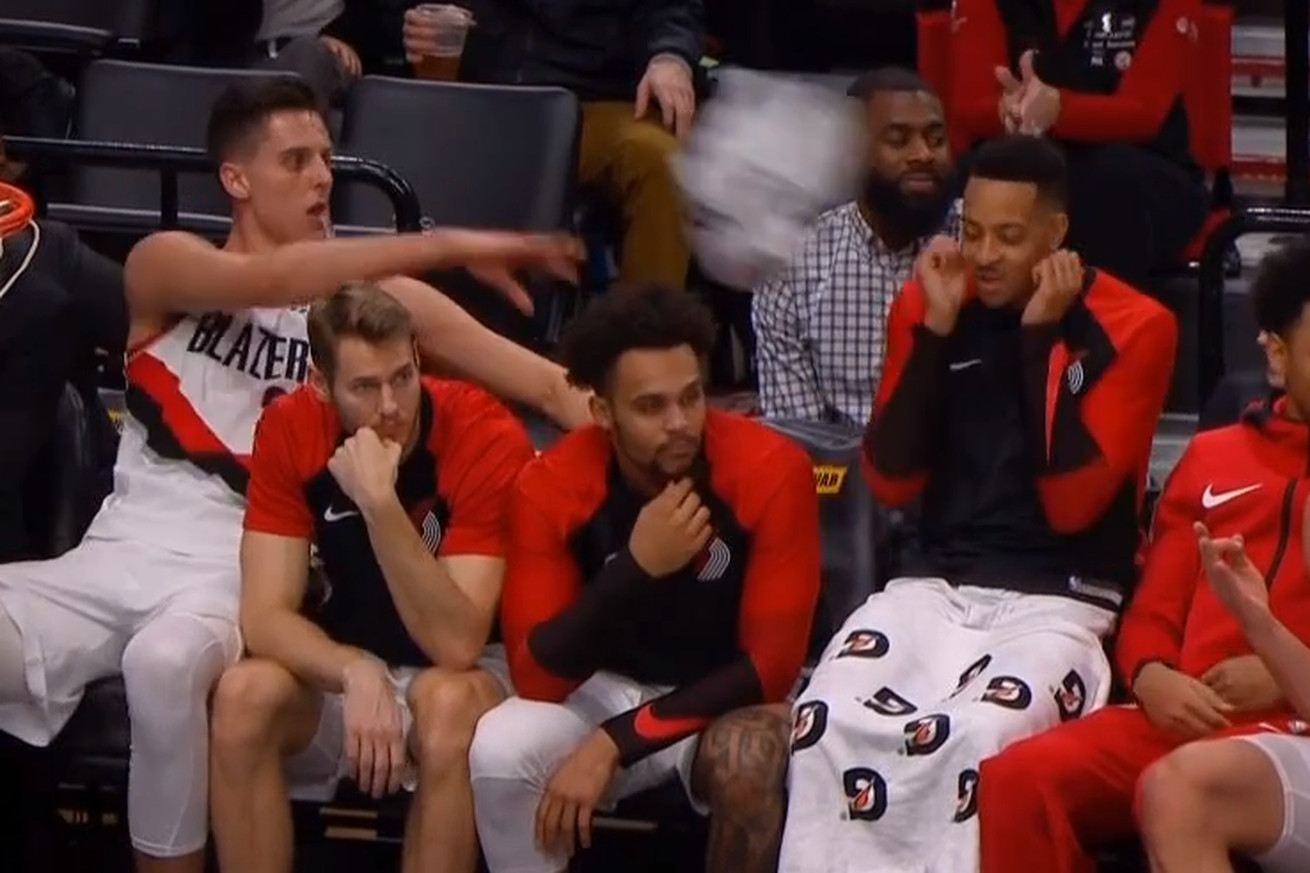 Untitled.0 - C.J. McCollum tried to keep Zach Collins calm and got a towel in his face