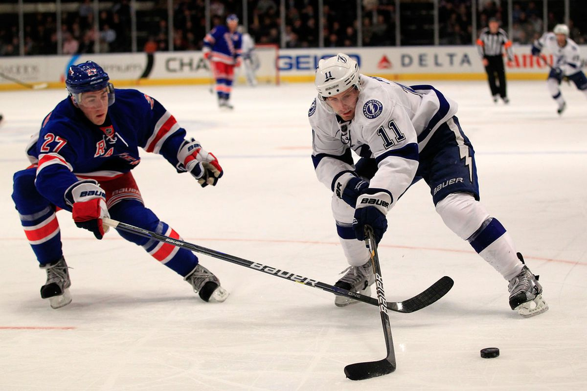 NEW YORK, NY - DECEMBER 08: (R) Tom Pyatt #11 of the Tampa Bay Lightning controls the puck from Ryan McDonagh #27 of the New York Rangers at Madison Square Garden on December 8, 2011 in New York City.  (Photo by Chris Trotman/Getty Images)