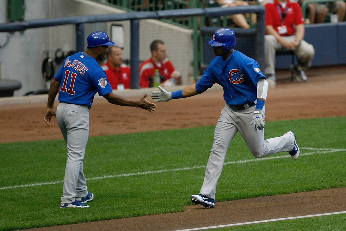 Starlin Castro of the Chicago Cubs is congratulated by Ivan DeJesus after hitting a home run during a game against the Milwaukee Brewers at Miller Park in Milwaukee, Wisconsin. The Brewers defeated the Cubs 5-2. (Photo by Scott Boehm/Getty Images)