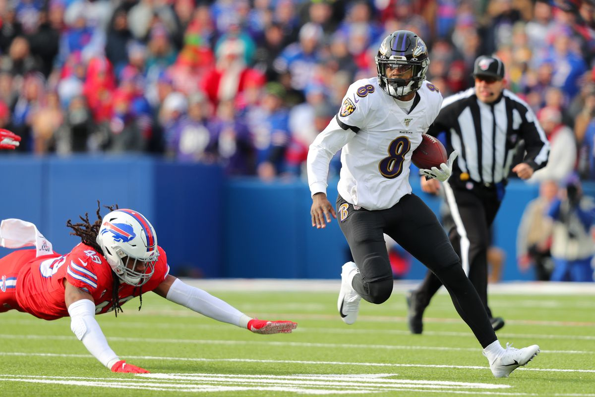 Tremaine Edmunds of the Buffalo Bills dives to try and tackle Lamar Jackson of the Baltimore Ravens as he runs the ball during the first quarter at New Era Field on December 8, 2019 in Orchard Park, New York.