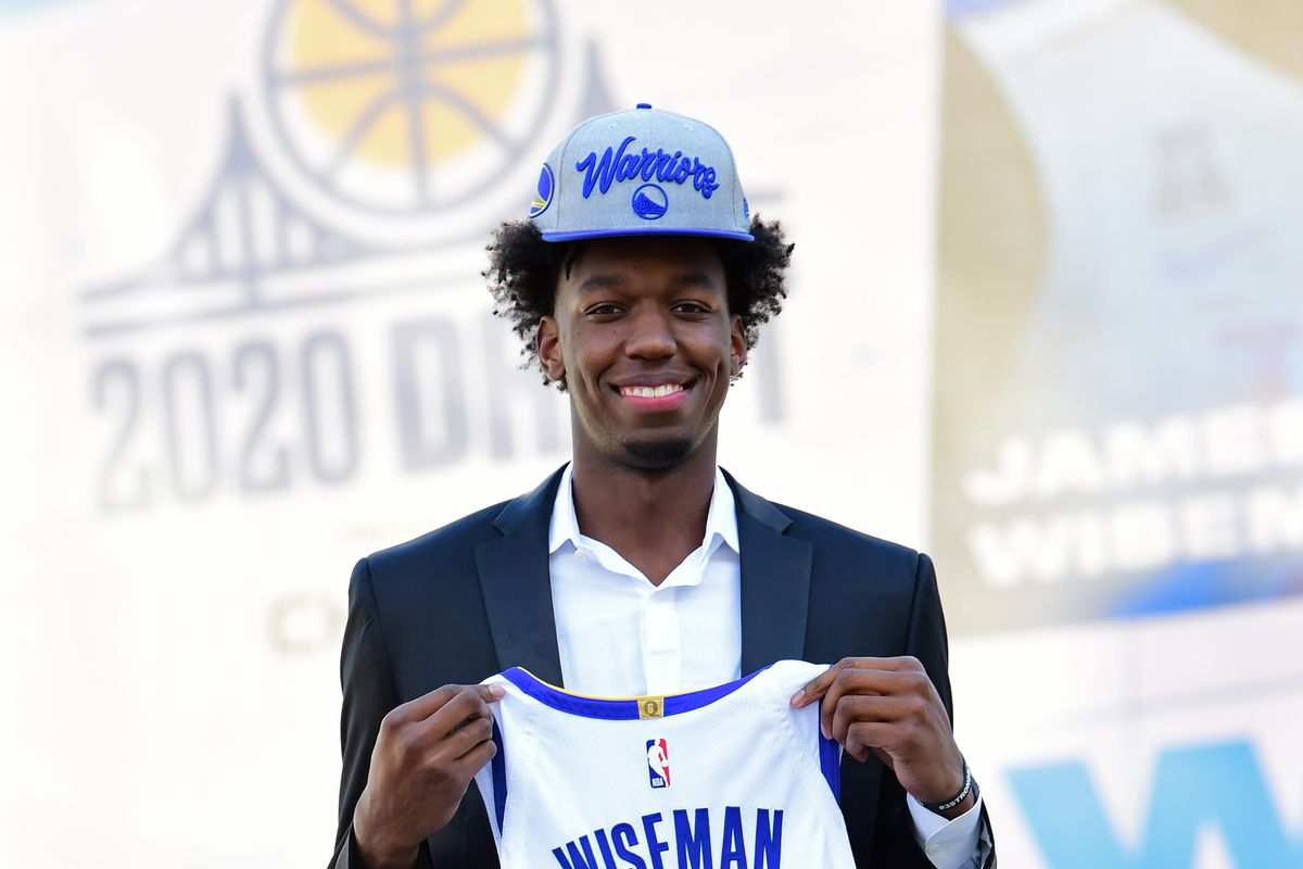 James Wiseman of the Golden State Warriors smiles and poses for a photo during a draftee press conference on November 19, 2020 in San Francisco, California at the Chase Center.