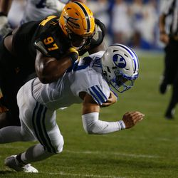 Brigham Young quarterback Jaren Hall, right, gets tackled by Arizona State defensive lineman Shannon Forman (97) during an NCAA college football game against Arizona State at LaVell Edwards Stadium in Provo on Saturday, Sept. 18, 2021.