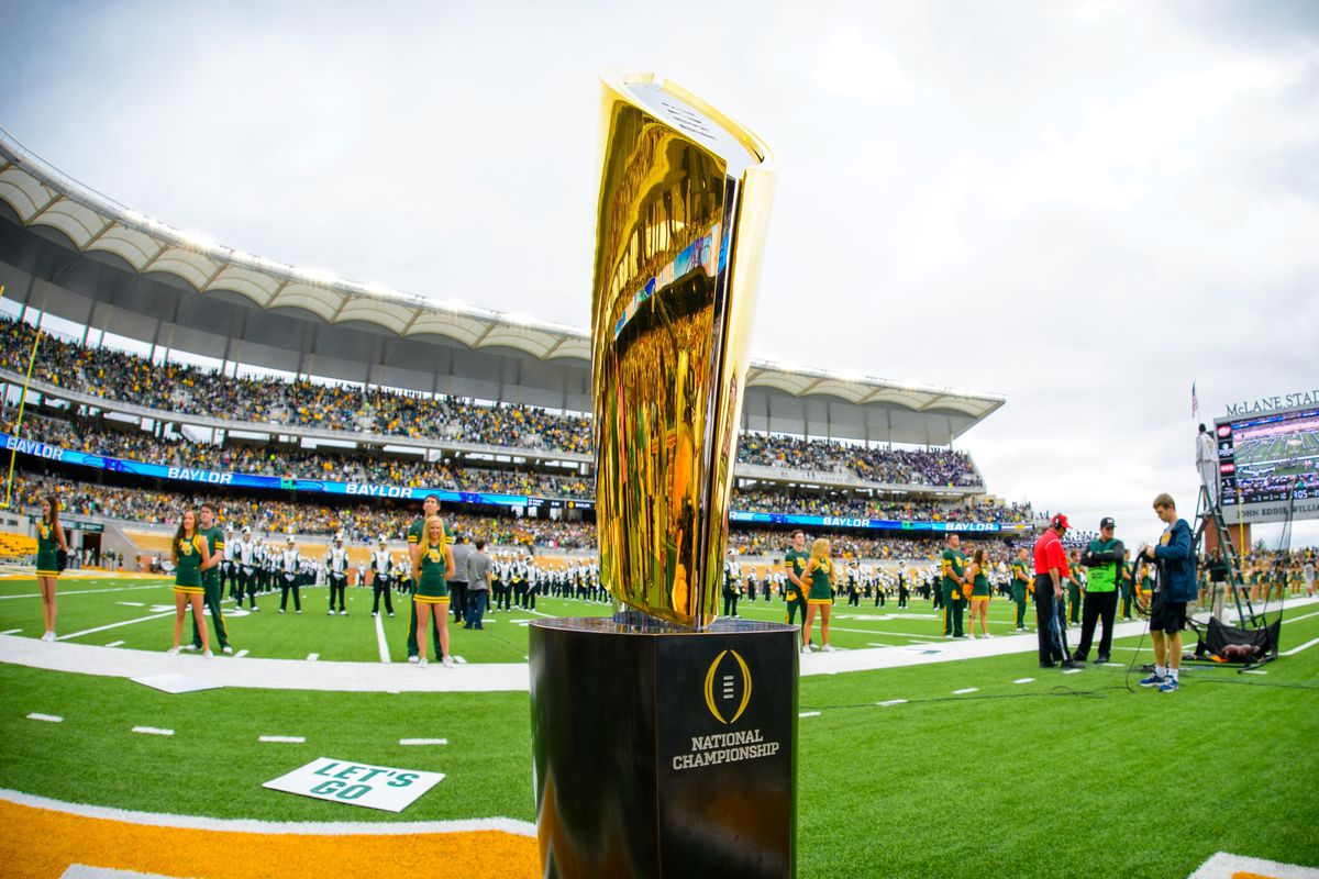 The College Football Playoff trophy on display at a Big 12 game. Go West, young man.