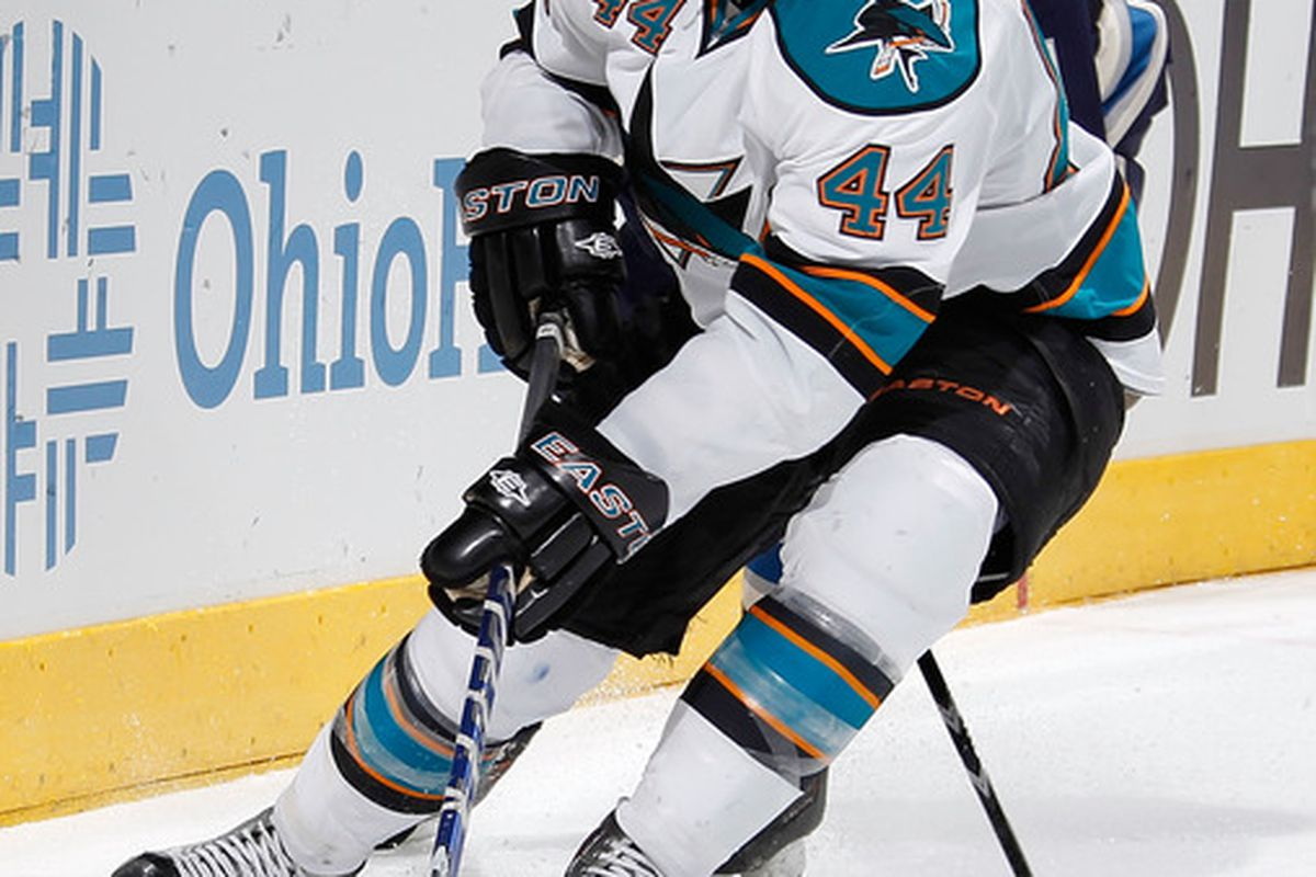 COLUMBUS, OH - JANUARY 14:  Marc-Edouard Vlasic #44 of the San Jose Sharks tries to control the puck while playing the Columbus Blue Jackets at Nationwide Arena on January 14, 2012 in Columbus, Ohio. (Photo by Gregory Shamus/Getty Images)