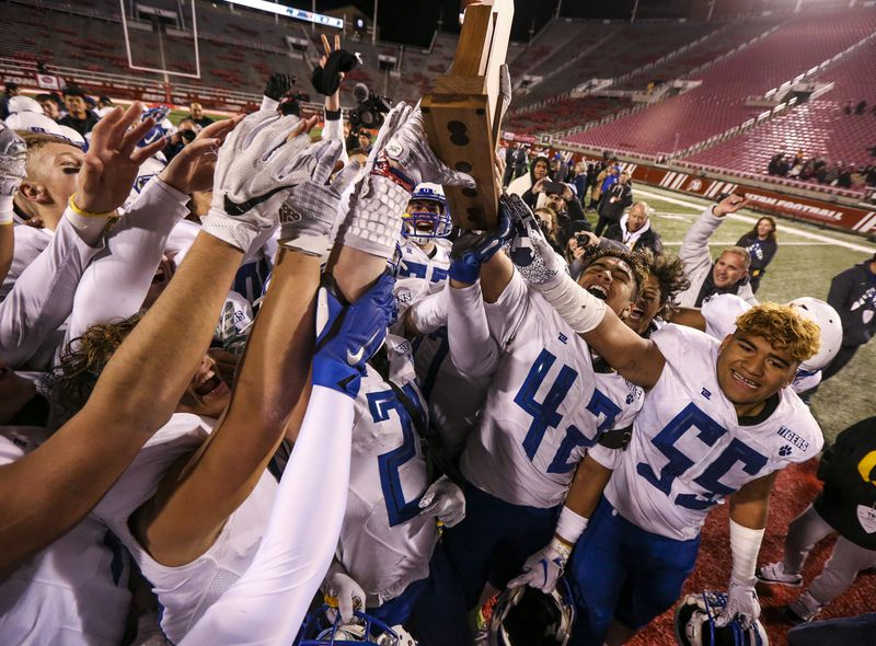 The Orem Tigers celebrate their 21-7 win over the Timpview Thunderbirds in the 5A state high school football game at Rice-Eccles Stadium in Salt Lake City on Friday, Nov. 22, 2019.