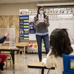 Preschool teacher Erin Berry teaches her students about washing their hands after breakfast Monday morning at Dawes Elementary School at 3810 W. 81st Pl. on the Southwest Side.