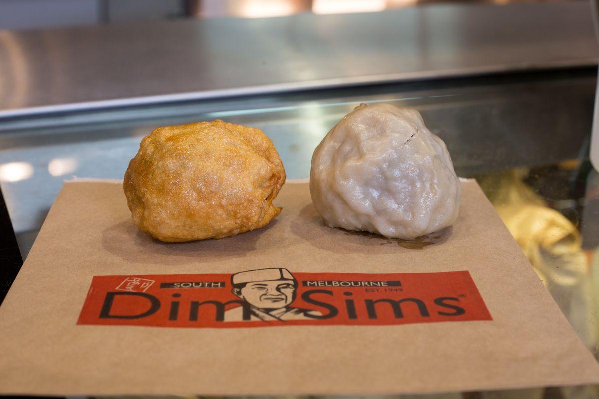 One crispy fried dim sim beside a steamed version