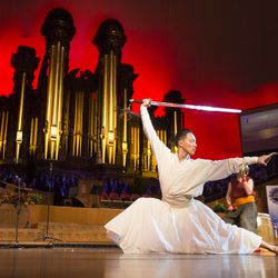 A dancer performs with a sword as Salt Lake Interfaith Roundtable presents Sacred Music, religious music, dance and performance representing faith traditions worldwide Sunday, Oct. 18, 2015, inside the tabernacle on Temple Square, in Salt Lake City.