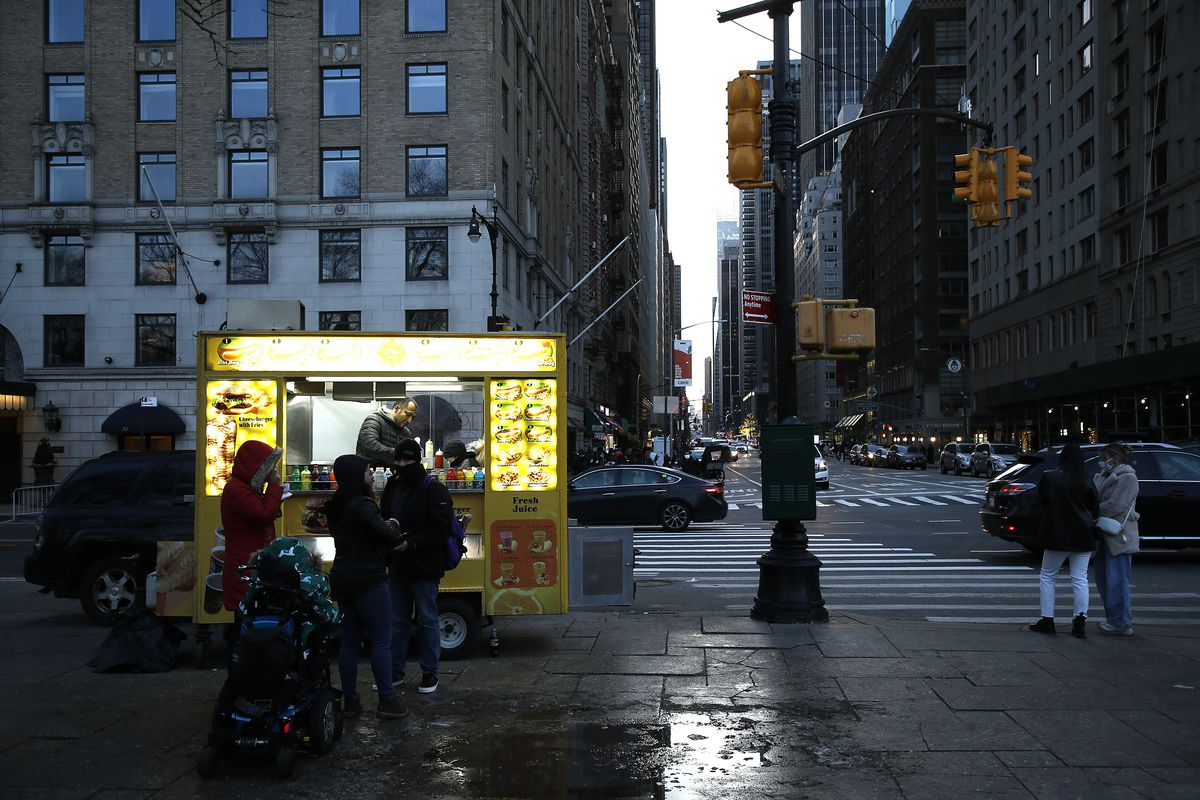 A street vendor sells food by Central Park on December 27, 2020 in New York City.