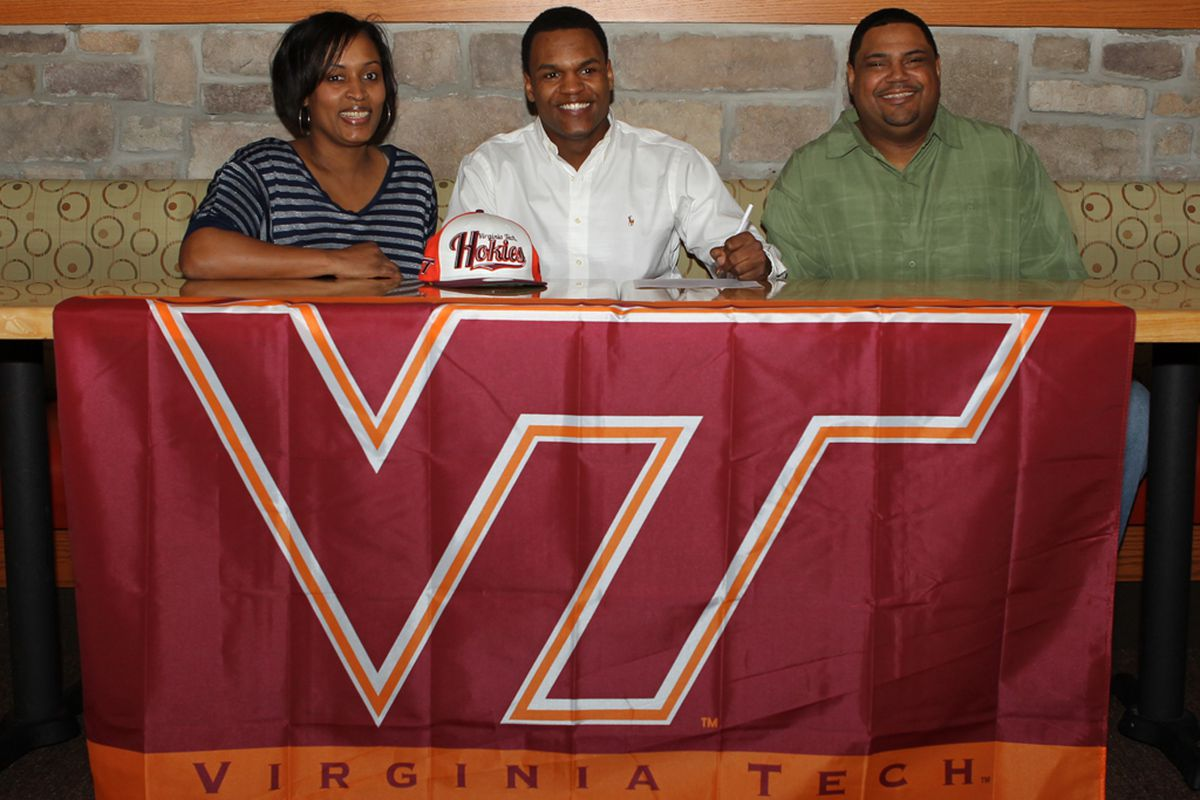 Drew Harris signs with the Hokies in 2012 with his mom and dad