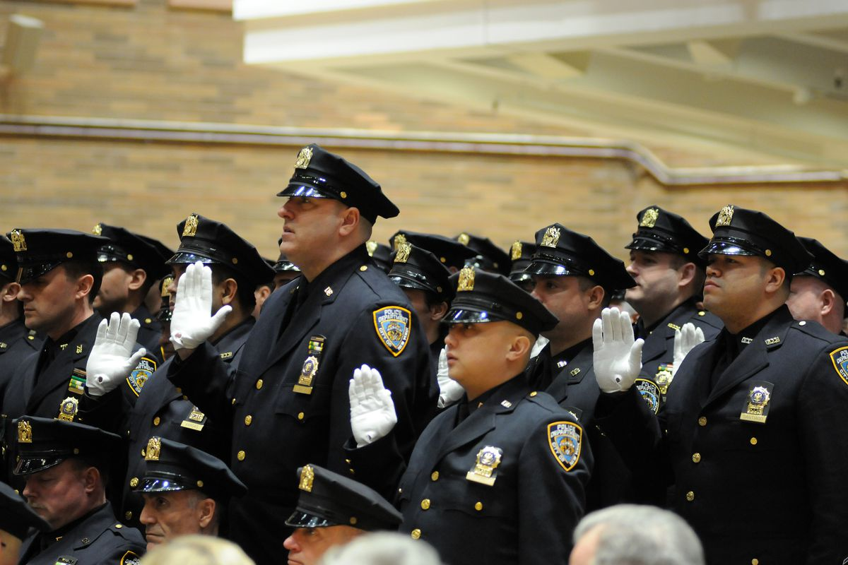 NYPD officers take an oath during a promotions ceremony at One Police Plaza, March 27, 2015.