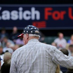 A couple looks for open seats in the Grande Ballroom as they get ready for Ohio Gov. John Kasich to hold a town hall meeting at Utah Valley University Friday, March 18, 2016.