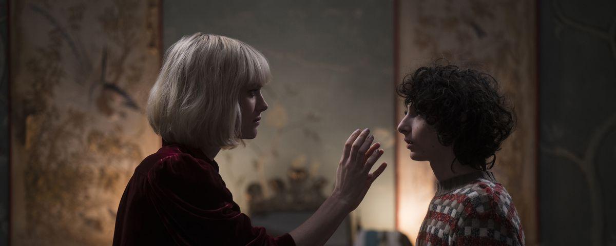 Kate Mandell (Mackenzie Davis) reaches for Miles Fairchild's (Finn Wolfhard) face in The Turning.