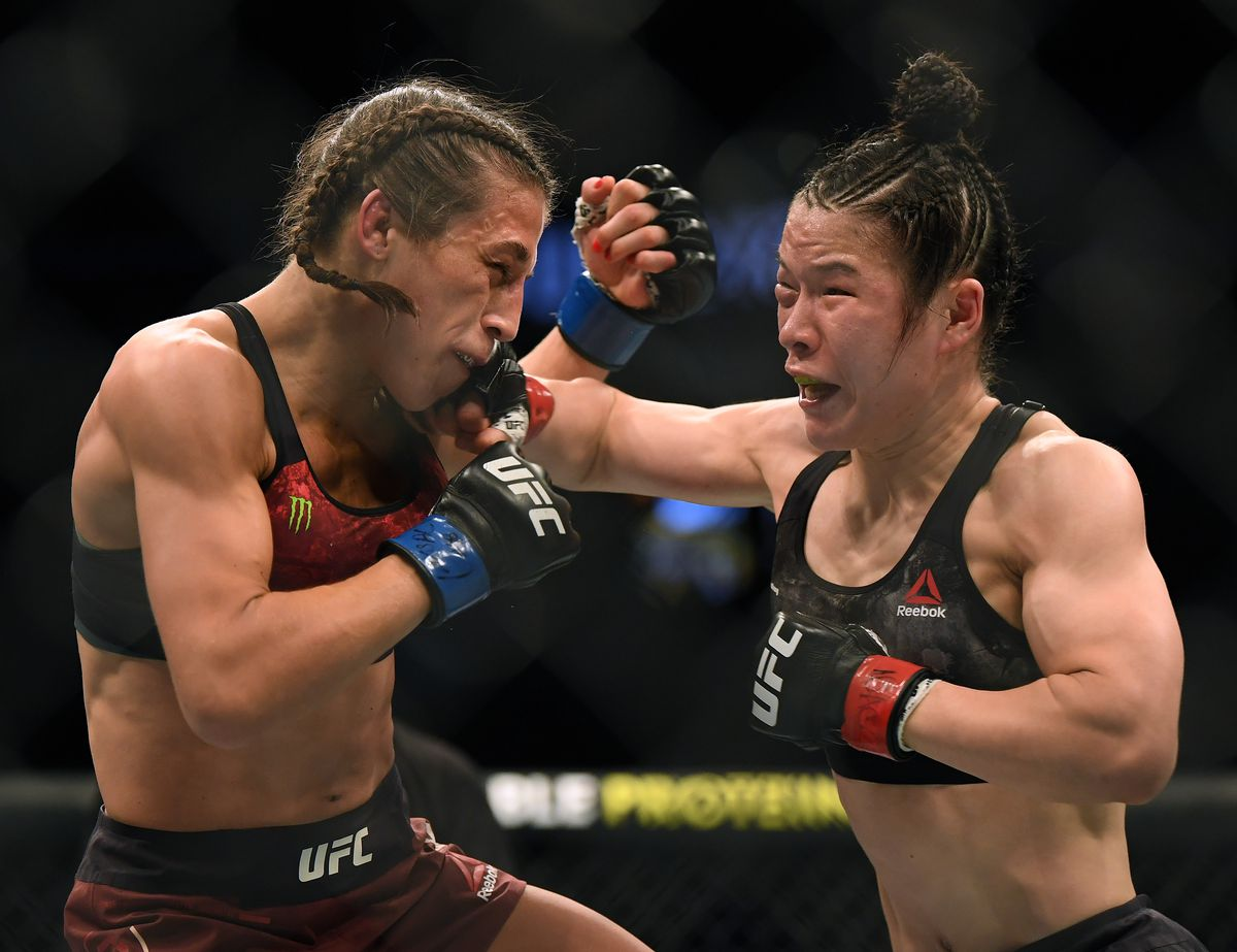 Weili Zhang lands a right hand on Joanna Jedrzejczyk at UFC 248.