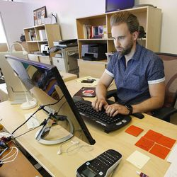 Blyncsy engineer Dallin Starr works at the company's office in Salt Lake City on Friday, July 14, 2017. Blyncsy has developed anonymized tracking of cellphones combined with data crunching to help solve transportation and movement dilemmas.