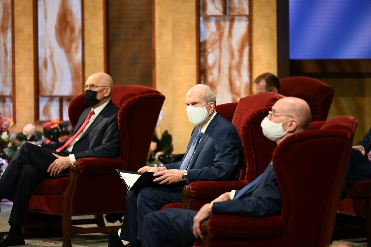 Each member of the First Presidency wears a face mask while seated in the Conference Center Theater.