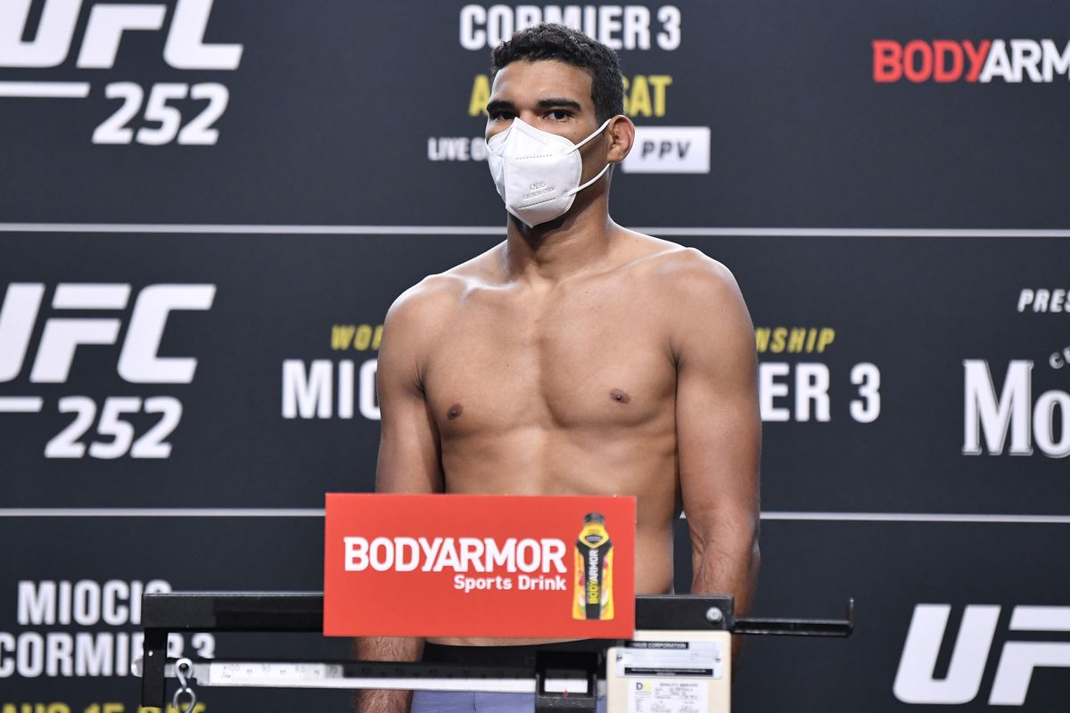 Herbert Burns of Brazil poses on the scale during the UFC 252 weigh-in at UFC APEX on August 14, 2020 in Las Vegas, Nevada.