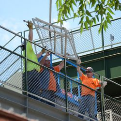 2:14 p.m. Fence section being lowered into the right-field bleachers -
