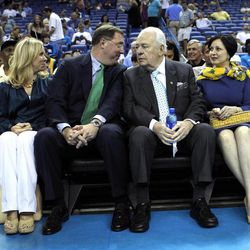 Tom Benson, the New Orleans Saints owner and to whom the NBA has agreed to sell the New Orleans Hornets, and his wife, Gayle Benson, right, sit with Dennis Lauscha, executive vice president of the Saints, and his wife Jennifer Lauscha, before an NBA basketball game between the Hornets and the Memphis Grizzlies in New Orleans, Sunday, April 15, 2012.
