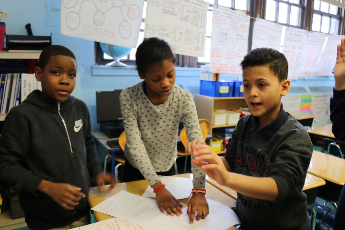 Students in Nicole Lent's fifth-grade math class at P.S. 294 debate the correct way to solve a problem.