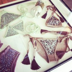 Bikinis with a cheetah crystal pattern and chunky tassles.