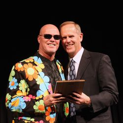 Former BYU quarterback Jim McMahon, left, poses with BYU athletics director Tom Holmoe. McMahon was one of five former All-Americans enshrined into the BYU Athletic Hall of Fame Thursday.