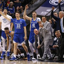 Brigham Young Cougars' bench celebrates a three point shot as BYU and Gonzaga play in an NCAA basketball game in the Marriott Center in Provo on Saturday, Feb. 24, 2018.