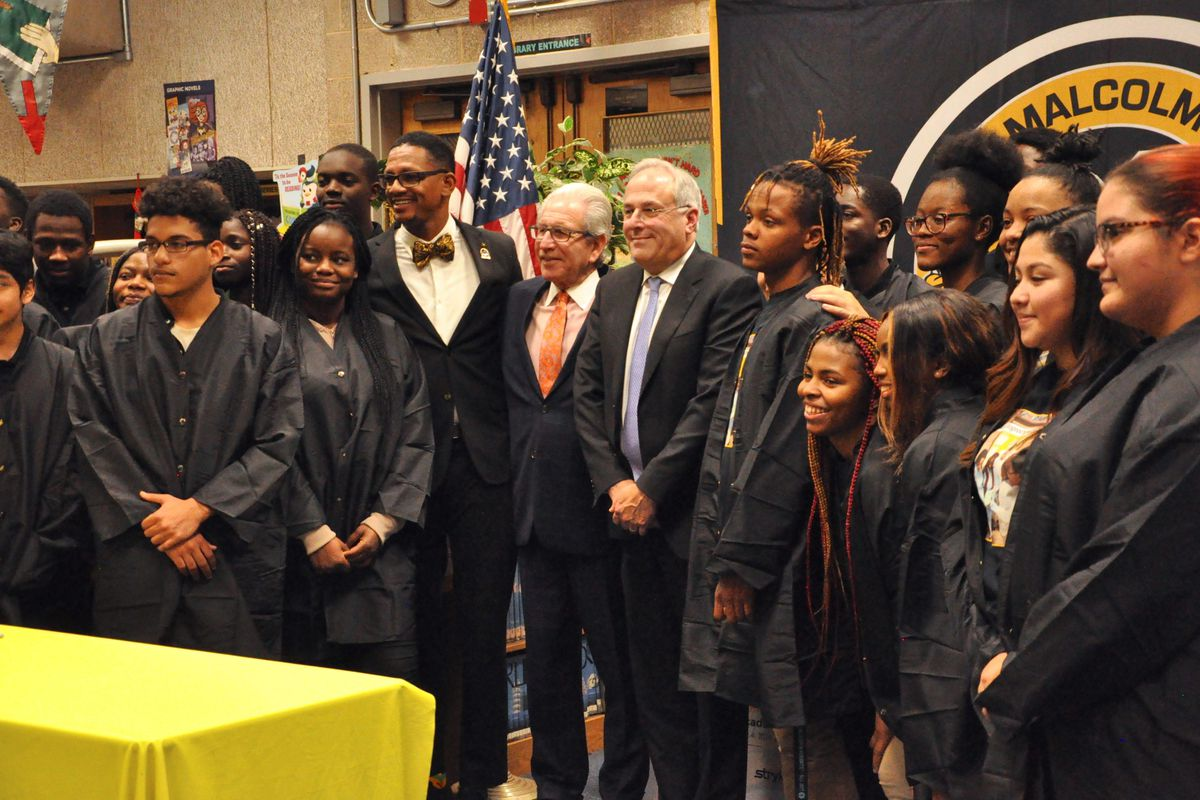 Malcolm X Shabazz High School students stand alongside Principal Naseed Gifted, center left, NJIT President Joel Bloom, and Stryker executive Robert Cohen at the academy's unveiling on Dec. 4, 2019.