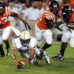 Georgia Tech quarterback Tevin Washington dives on the ball to regain possession while under pressure from Virginia Tech outside linebacker Jeron Gouveia-Winslow and defensive end J.R. Collins (42) during the first half of an NCAA college football game, Monday, Sept. 3, 2012, in Blacksburg, Va.