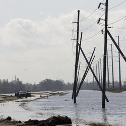 A truck is stranded from receding flood waters from Hurricane Isaac along Louisiana Hwy 23 near Port Sulphur, La., in Plaquemines Parish, Monday, Sept. 3, 2012.