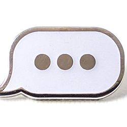 """Pintrill speech bubble pin, <a href=""""https://www.shopspring.com/brands/1070/products/5860490"""">$12</a> at Spring"""
