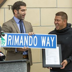 Sandy Mayor Kurt Bradburn presents Real Salt Lake's goalkeeper Nick Rimando with a street sign and proclaims it Nick Rimando Day in Sandy at a ceremony at Rio Tinto Stadium in Sandy on Friday, Sept. 27, 2019. Rimando will play his last home game on Sunday.