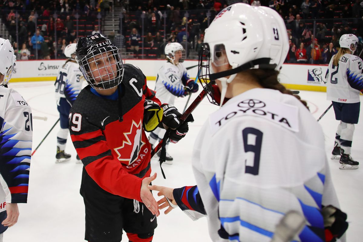 Marie-Philip Poulin #29 of Canada shakes hands with Megan Bozek #9 of the United States after a 2-0 Canada win at Little Caesars Arena on February 17, 2019 in Detroit, Michigan.