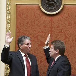 New Utah House of Representatives speaker David Clark is sworn in by former speaker Greg Curtis to his new post at the start of the 2009 session of the Utah Legislature at the Capitol building in Salt Lake City, Monday.