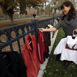 Laurie Summers-Pisani volunteers at the 10th annual Community Coat Exchange at Pioneer Park in Salt Lake City on Friday, Nov. 28, 2014.