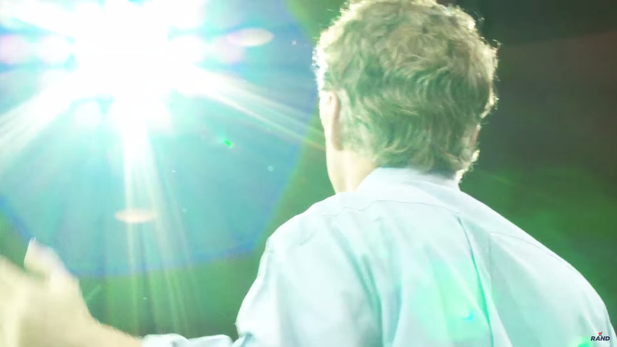 Rand Paul has light beaming down upon him from above.