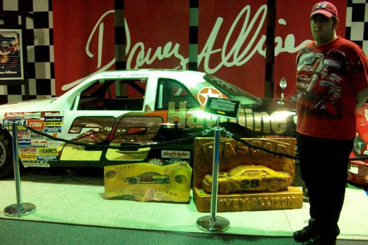 """Thats me standing with Davey Allison's 1987 #28 Texaco Ford, """"Superstar."""" I felt like I was in the presence of more than a race car, however. Photo Credit: Genna Short"""