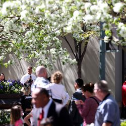 People enjoy the weather during a break in the 187th Annual General Conference of The Church of Jesus Christ of Latter-day Saints in Salt Lake City on Saturday, April 1, 2017.