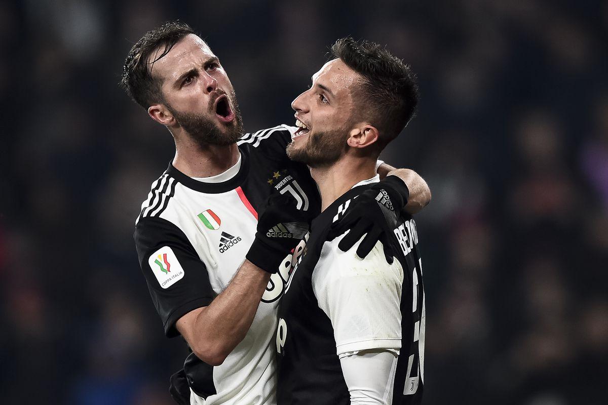 Rodrigo Bentancur (R) of Juventus FC celebrates with Miralem...