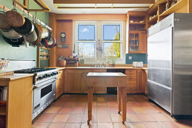 Kitchen with stainless steel appliances and wooden cabinets.