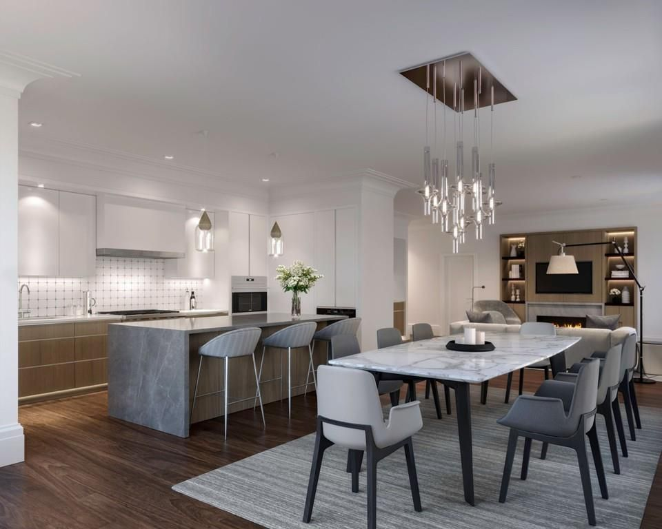 A large, airy living room-dining room area with furniture and a very modern look.