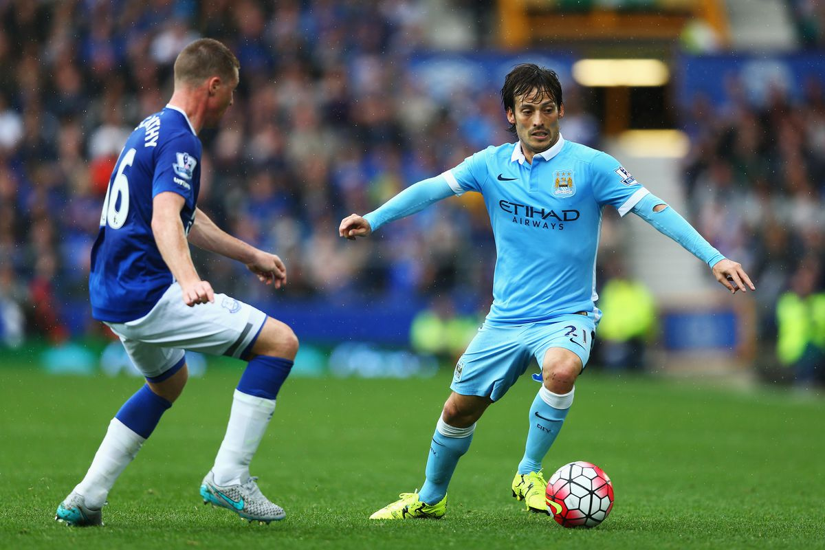 David Silva of Manchester City takes on James McCarthy of Everton during the Barclays Premier League match between Everton and Manchester City at Goodison Park on August 23, 2015 in Liverpool, England.