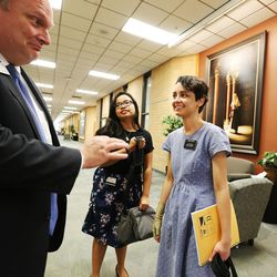 Sister Fanny Clain, right, and her companion Aniela Santoso talk with Spencer Christensen at the Missionary Training Center in Provo May 27, 2016. Clain was a victim of the Brussels terrorist attack. She has recovered and is now leaving to the Ohio Cleveland Mission.